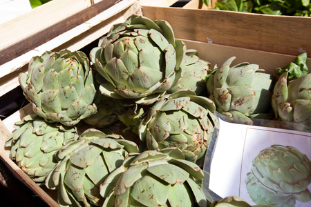commercialism: Fresh artichoke in container at market