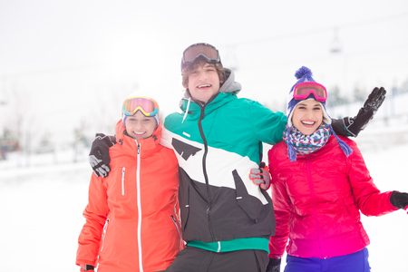 Portrait of young man with female friends enjoying in snow Stock Photo