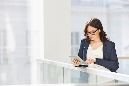 Young businesswoman using tablet PC in office
