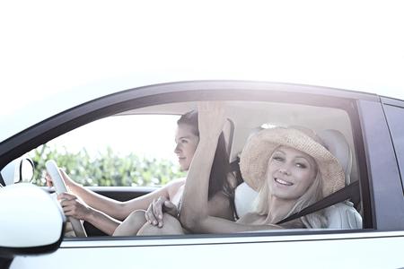 Happy women enjoying road trip on sunny day
