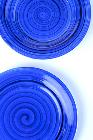 eating utensil: Blue plates on white background LANG_EVOIMAGES