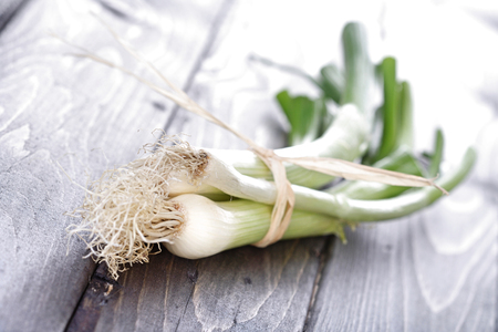 wales: Leeks on wooden table - close-up LANG_EVOIMAGES