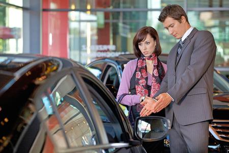 Car salesman explaining car features to customer LANG_EVOIMAGES