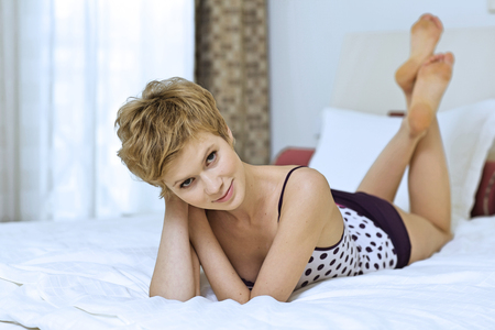 pyjama: Young woman in bed