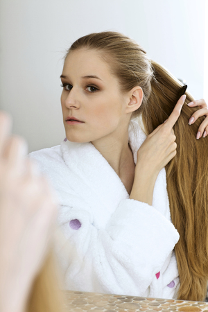 Woman brushing hair Stock Photo