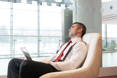 zoned: Bored businessman stares out window LANG_EVOIMAGES