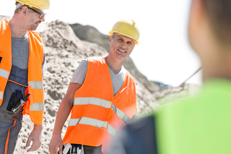 incidental people: Happy supervisor with colleague at construction site