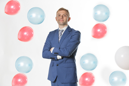 Businessman standing by falling  balloons