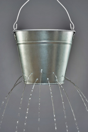 Leaky Bucket Stock Photo