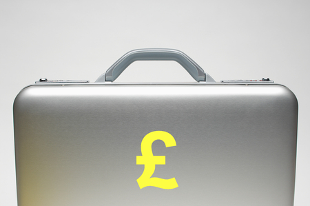 trade secret: Silver briefcase with sterling symbol on it