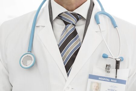 Midsection of doctor in labcoat with stethoscope at clinic