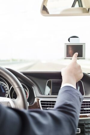 Executive using GPS navigation inside car