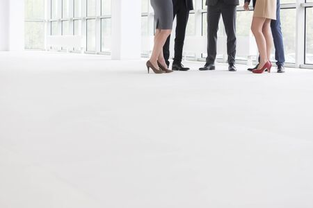 Low section of business colleagues standing in new office Stock fotó