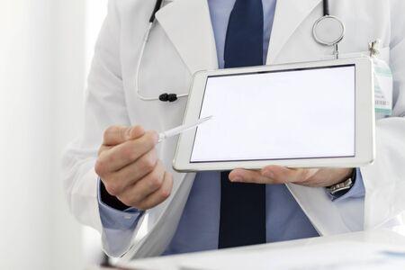 Doctor in labcoat showing digital tablet at hospital Stock fotó