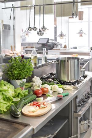 Fresh vegetables on counter in kitchen at restaurant