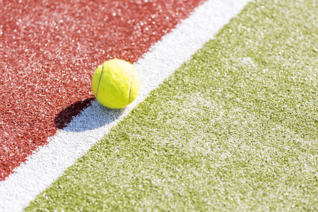 High angle view of tennis ball on court during sunny day