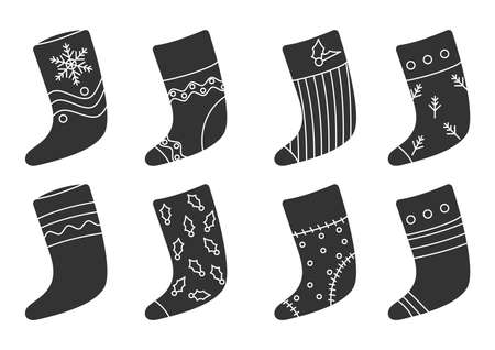 Glyph Christmas sock set. Santa boot with snowflake, berry. Traditional retro Xmas stocking for gift. Accessories for winter presents. Home decoration on New Year Isolated on white vector illustration