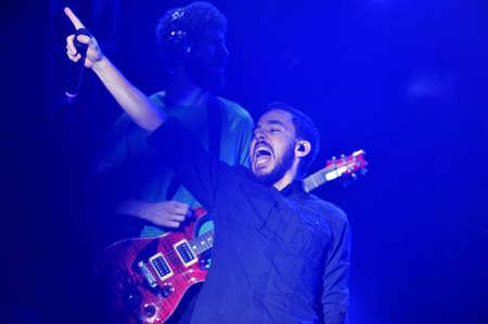 BANGKOK THAILAND SEPTEMBER 23 :Mike Shinoda of Linkin Park perform on Linkin Park Live in Bangkok A Thousand Suns World Tour 2011 at Impact Maungthong Thani, September 23,2011 Bangkok Thailand Stock Photo - 10853840