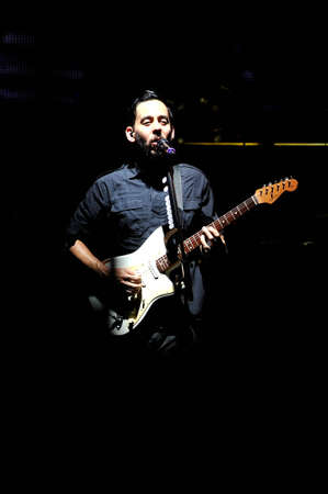 BANGKOK THAILAND SEPTEMBER 23 :Mike Shinoda of Linkin Park perform on Linkin Park Live in Bangkok A Thousand Suns World Tour 2011 at Impact Maungthong Thani, September 23,2011 Bangkok Thailand