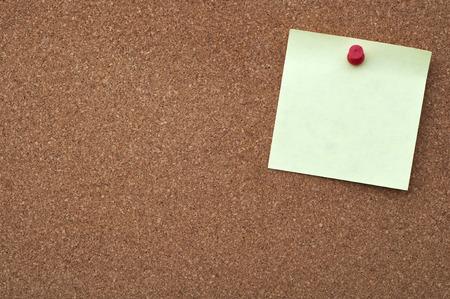 Sticky note on cork board photo