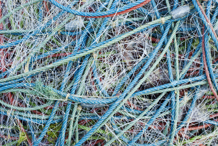 Abstract background with a pile of nylon fishing nets photo