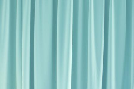 sipario chiuso: Light blue closed curtain background.