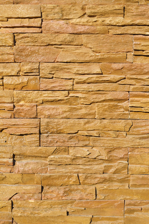 floor covering: Construction texture of brick stone wall for exterior background.