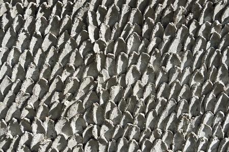 escamas de pez: Pared del cemento rayado escamas de pescado. Foto de archivo