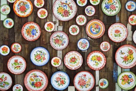 room decoration: Colorful Thai round tray on the wood wall. Stock Photo