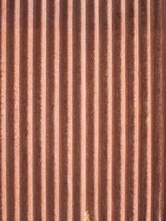 siding: Rusted, galvanized, corrugated iron siding, vintage background.