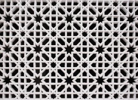 lattice window: White brick wall with air vents. Stock Photo