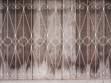 lattice window: Old wooden window with iron bars . Stock Photo
