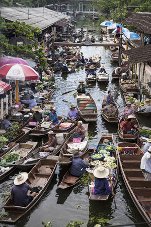 practiced: RATCHABURI THAILAND -Oct 3: Wooden boats are loaded with fruits from the orchards at Tha kha floating market on October 3, 2015 in Ratchaburi,Thailand. A traditional way still practiced in Tha kha canals of Thailand.
