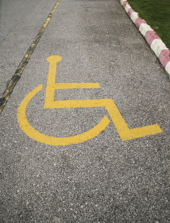 immobility: Handicapped symbol on parking space.