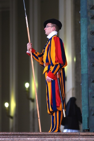 Vatican - March 14, 2011 - Swiss guard in Vatican in colourful uniform on duty Editorial