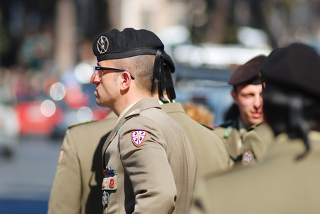 Rome, IT - March 10, 2011, Piazza Venezia, Italian military man in the grey uniform standing in the group of militaries