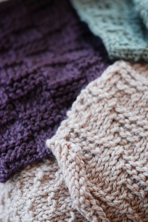 Knitted fabric samples of three different colours