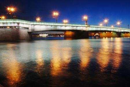 Saint-Petersburg night bridge in the lights over the blue river Neva