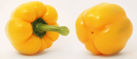 Two yellow peppers on white background