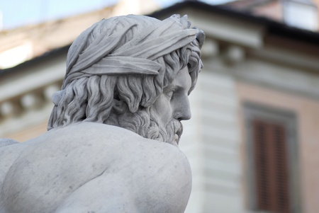 Profile of River God Ganges stone sculpture. Fountain at Piazza Navona Stock Photo