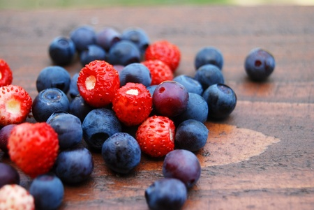 Delicious forest berries on the wooden table. Close-up, shallow dof