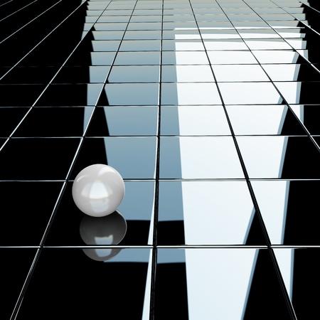 Small white sphere on a glossy black background Standard-Bild