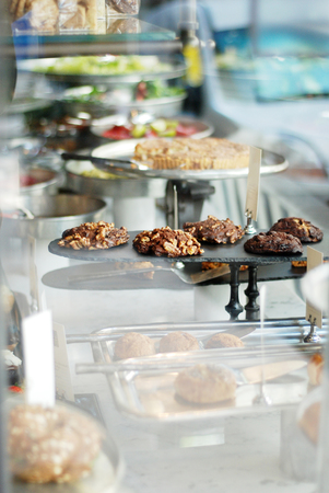 Baked healthy cookies in a vitrine of a cafe