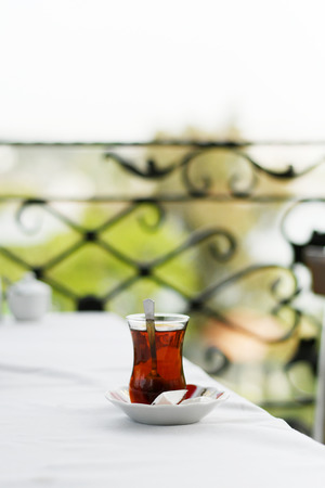 Tea in traditional turkish glass on a table