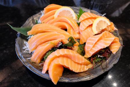 jumbo: Jumbo salmon sashimi in clear bowl Stock Photo