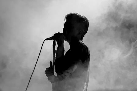 signer: Singer in silhouette