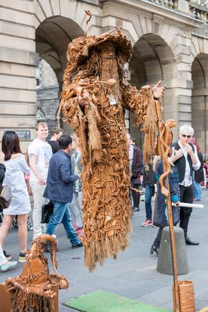 Edinburgh, Scotland - 29 August, 2016: Artist performing on Fringe Festival on the Royal Miles. It is the world largest arts festival, the annual festival hold every August. Edinburgh, United Kingdom Editorial