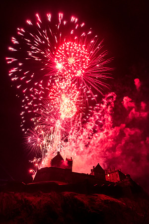 Edinburgh Hogmanay. New Years Eve Celebration Fireworks at Edinburgh Castle, Scotland Editorial