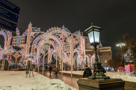 pavers: Moscow, Russia. 16 December 2016 : People walking around the city of Moscow, decorating with Christmas light. New Year in Moscow, Russia.