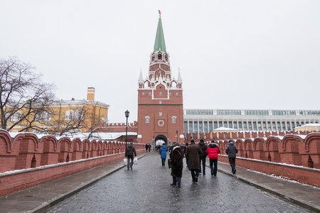 spasskaya: Moscow, Russia. 17 December 2016 : People walking in front of the entrance, Spasskaya Tower of Moscow Kremlin, Russia in winter. Editorial